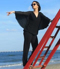 Pantaloni de ocazie din jerse elastic cu efect lucios